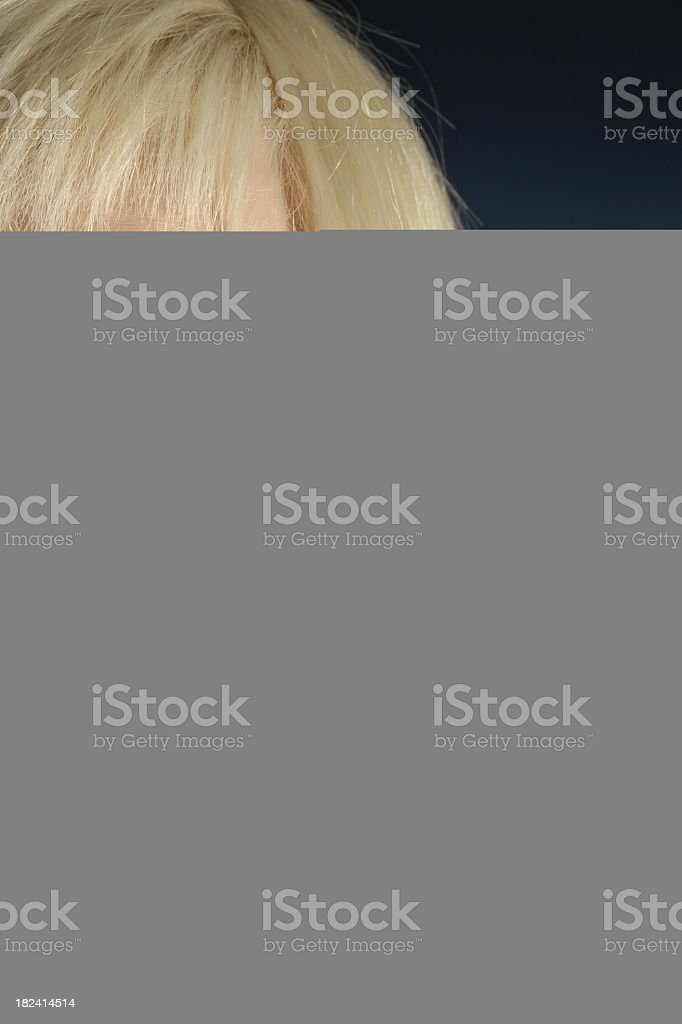 Mostly gray picture with the top part showing person's hair - Royalty-free Analyzing Stock Photo