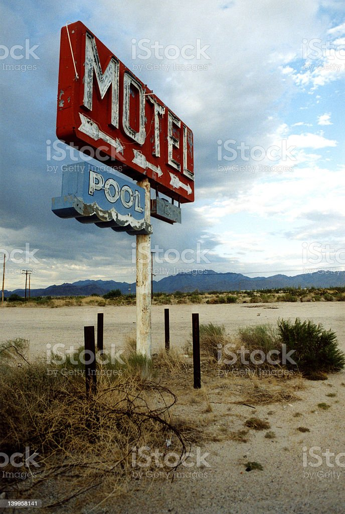 Motel and Pool Sign in Desert royalty-free stock photo