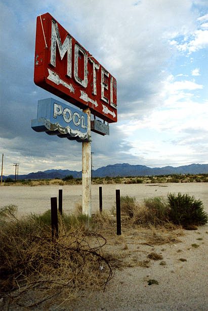 Motel and Pool Sign in Desert stock photo