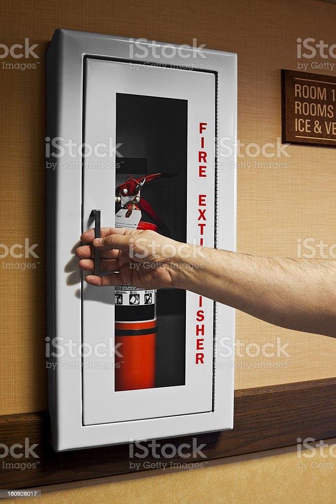 Motel Fire Extinguisher Opening stock photo