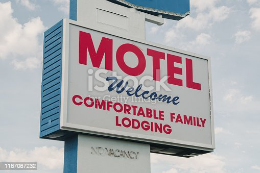 Motel sign in blue and red on a road in Las Vegas