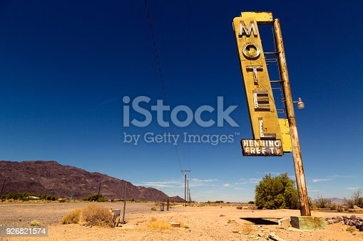 Vintage rusty motel sign on Route 66 in American desert land