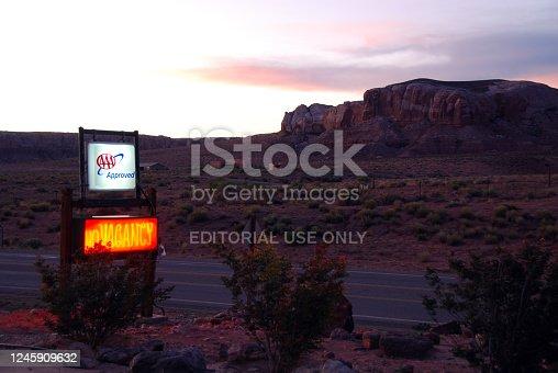 Bluff, Utah, 09/20/2011 illuminated neon motel sign in the desert at dusk