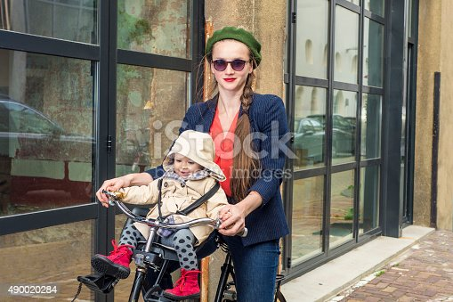 istock Moter and baby daughter on a bicycle 490020284