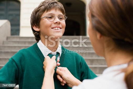 istock Mother adjusting sons tie 74410303