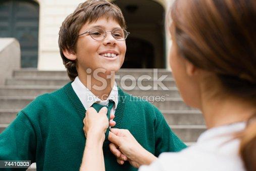 istock Mother adjusting sons tie 74410303