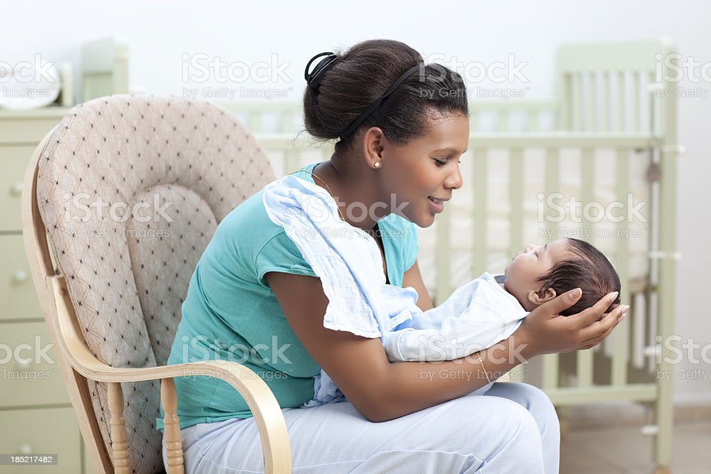 Mother admiring her baby. stock photo