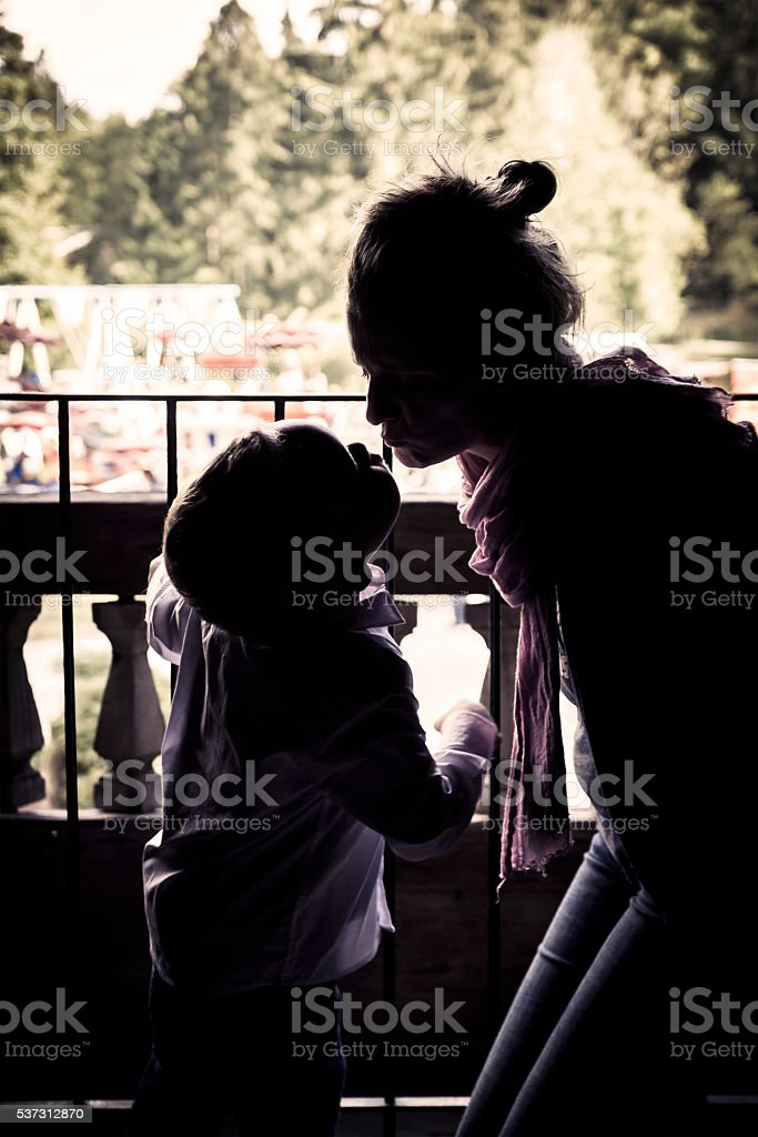Mother and 4 Yeard Old Son Kiss stock photo