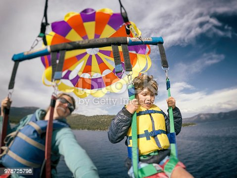 Mom and son parasailing over Lake Tahoe California