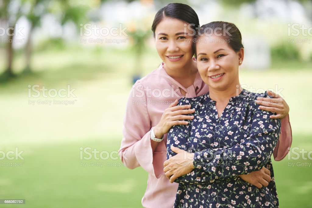 Mother and adult daughter stock photo