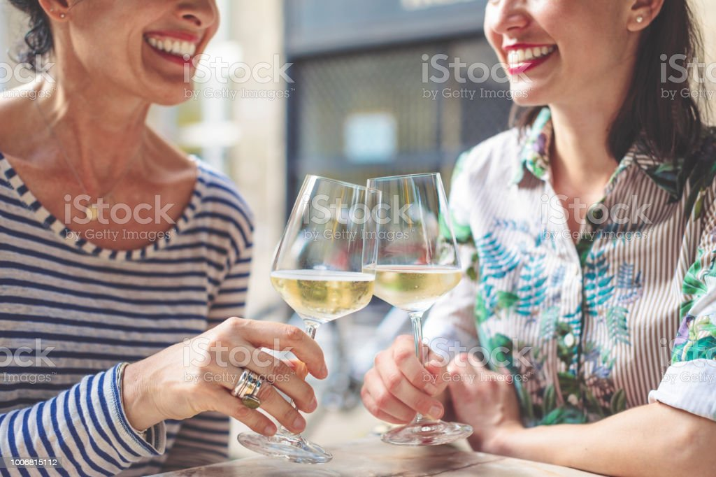 Mother and adult daughter spending time together stock photo