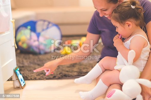 istock mother and baby are watching at phone 578807538