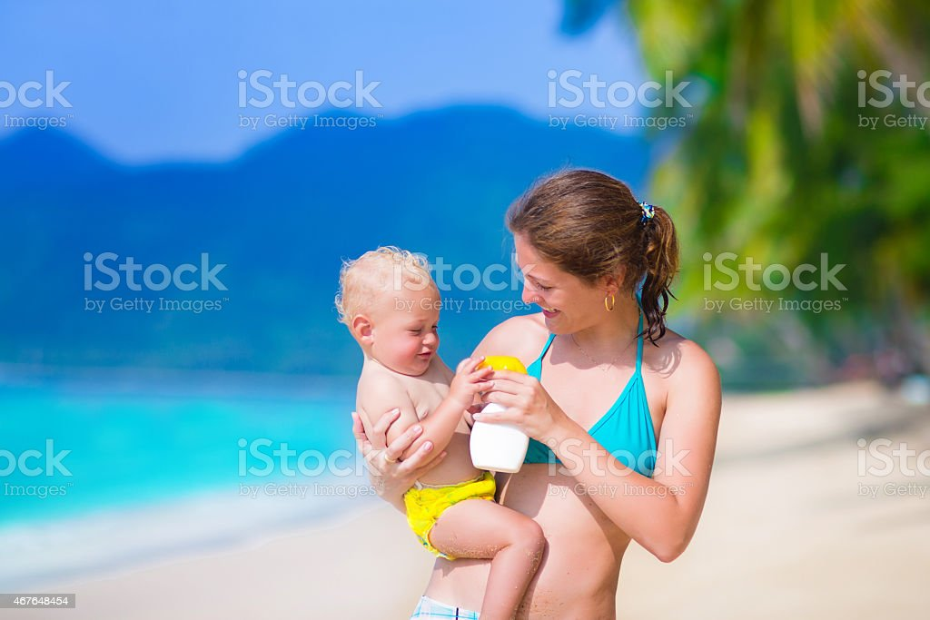 Mother and baby at a beach stock photo