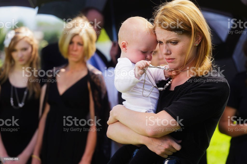 Mother and Baby at a Funeral stock photo