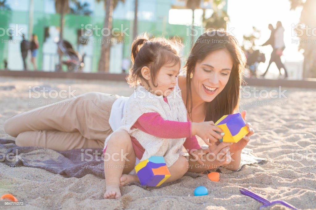 Mother and baby at the beach. royalty-free stock photo