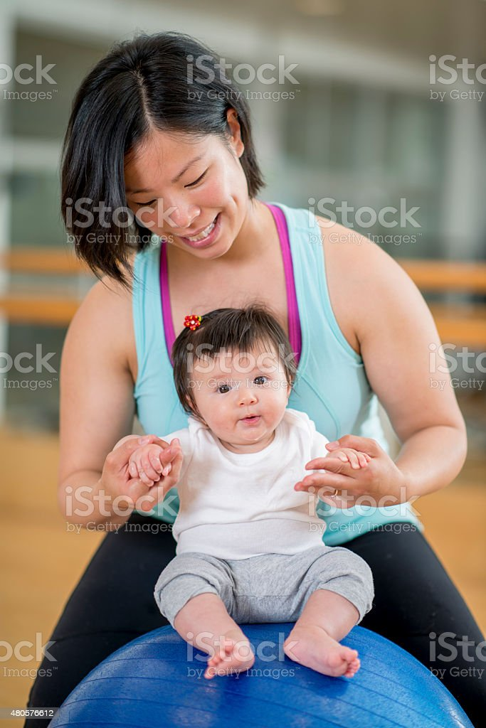 Mother and Baby at the Gym stock photo