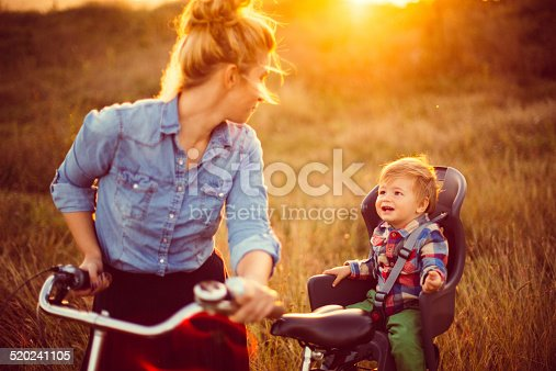 istock Mother and baby cycling together 520241105