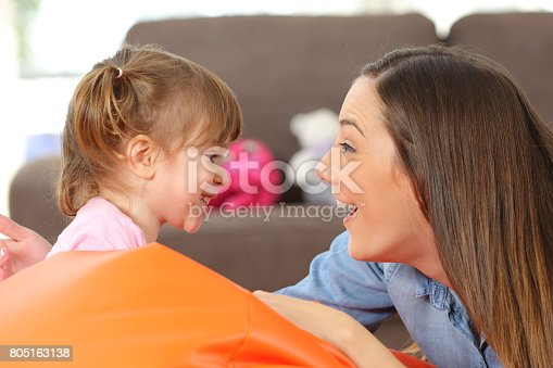 1063760138 istock photo Mother and baby daughter facing 805163138