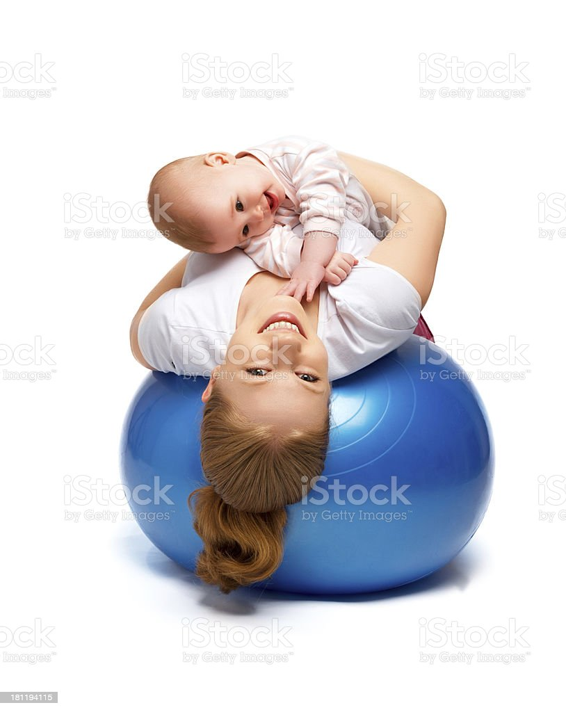 mother and baby doing gymnastic exercises on ball royalty-free stock photo