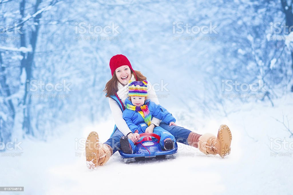 Mother and baby enjoying a sleigh ride stock photo