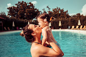 Mother and baby girl at swimming pool