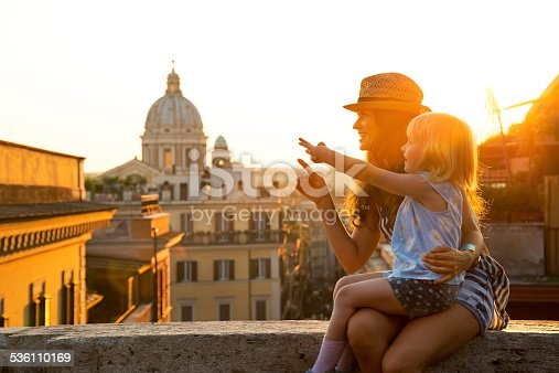 istock Mother and baby girl sitting on street in Rome 536110169