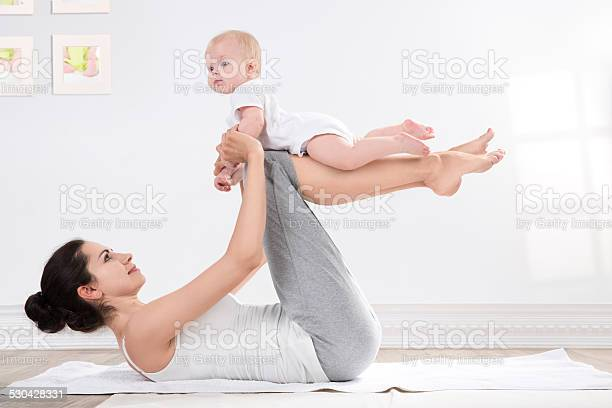 Mother And Baby Gymnastics Stock Photo - Download Image Now