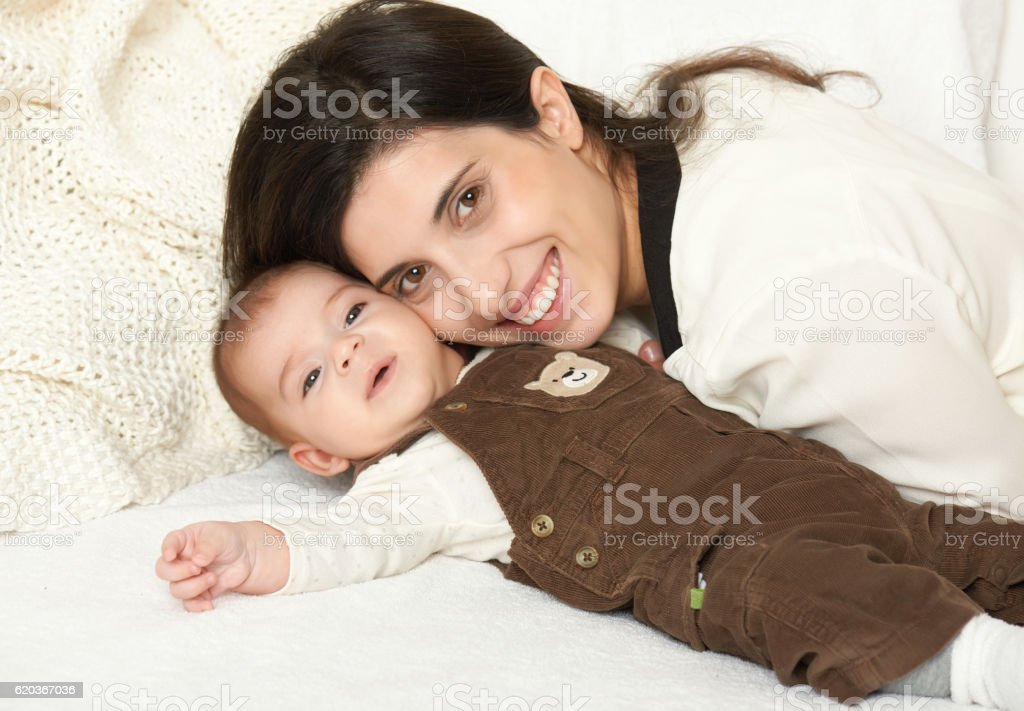 Mother and baby, happy family portrait on white background zbiór zdjęć royalty-free