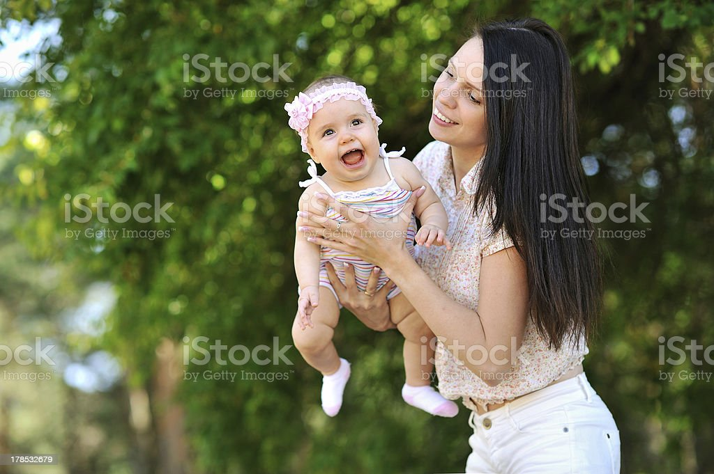 Mother and baby in a park royalty-free stock photo