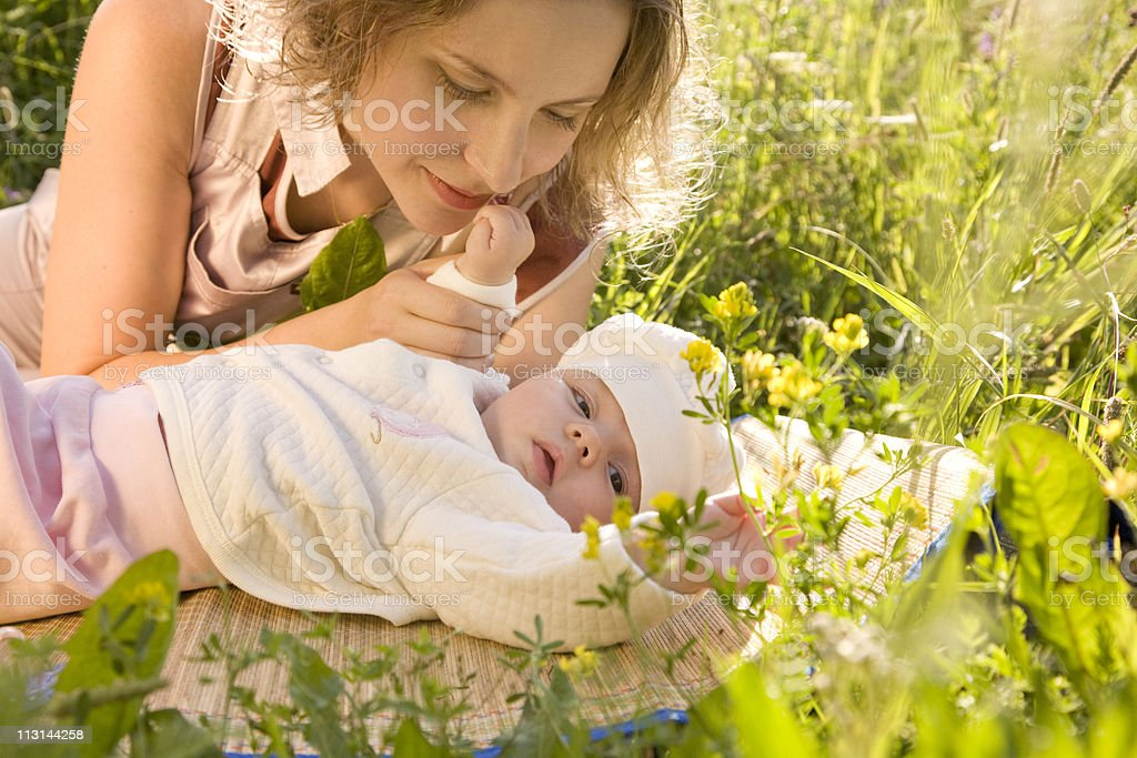 Mother and baby in the grass. stock photo