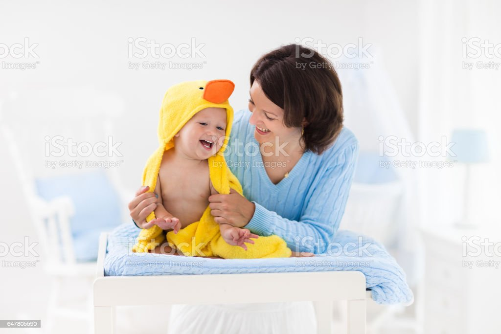 Mother and baby in towel after bath - foto de acervo