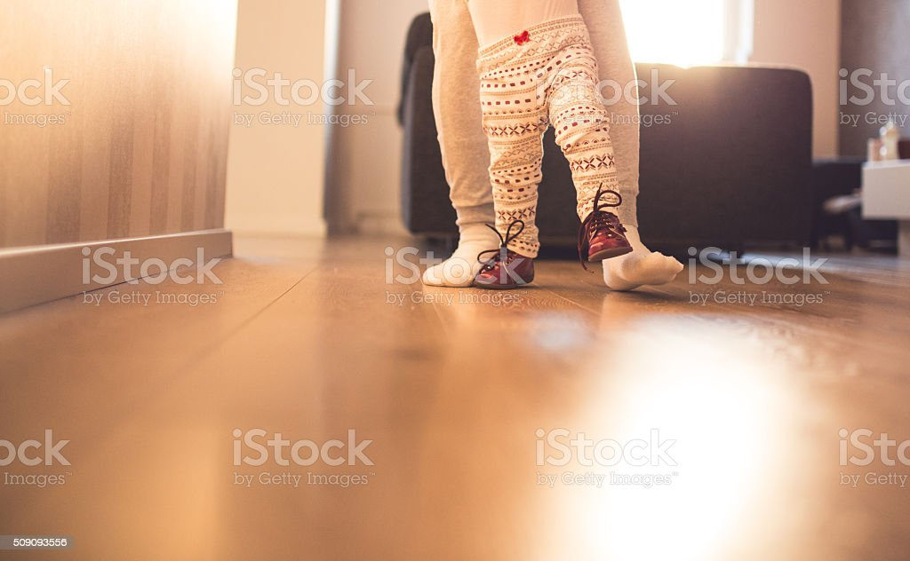 Mother and baby legs. First steps. stock photo