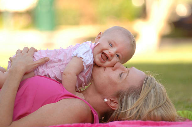 Mother and Baby on a Blanket in the Park stock photo