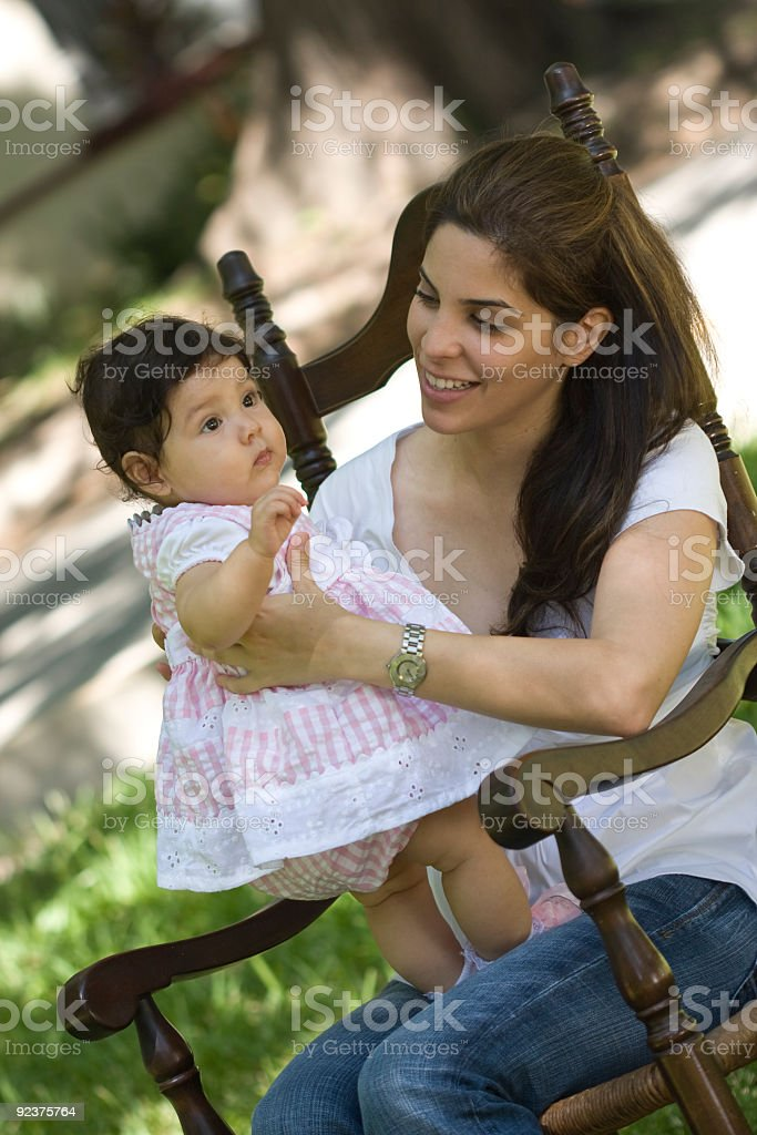 Mother and baby on rocking chair royalty-free stock photo