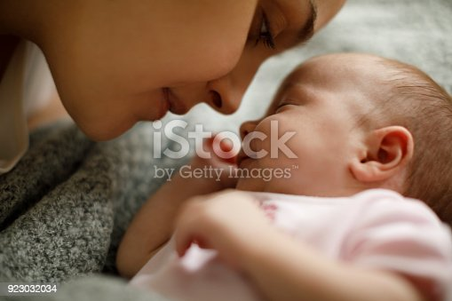 istock Mother and baby playing in the bed 923032034
