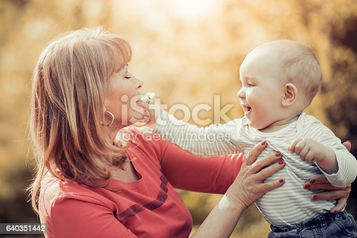 istock Mother and baby relaxing in the park 640351442