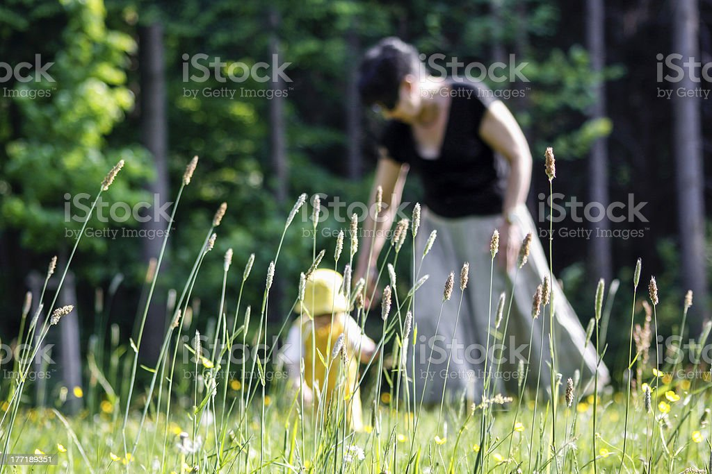Mother And Baby Walking In Garden royalty-free stock photo
