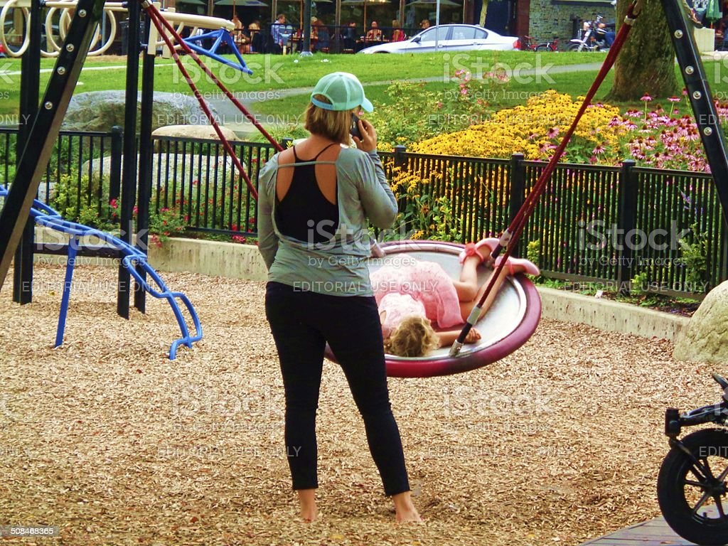 Mother and child at park stock photo