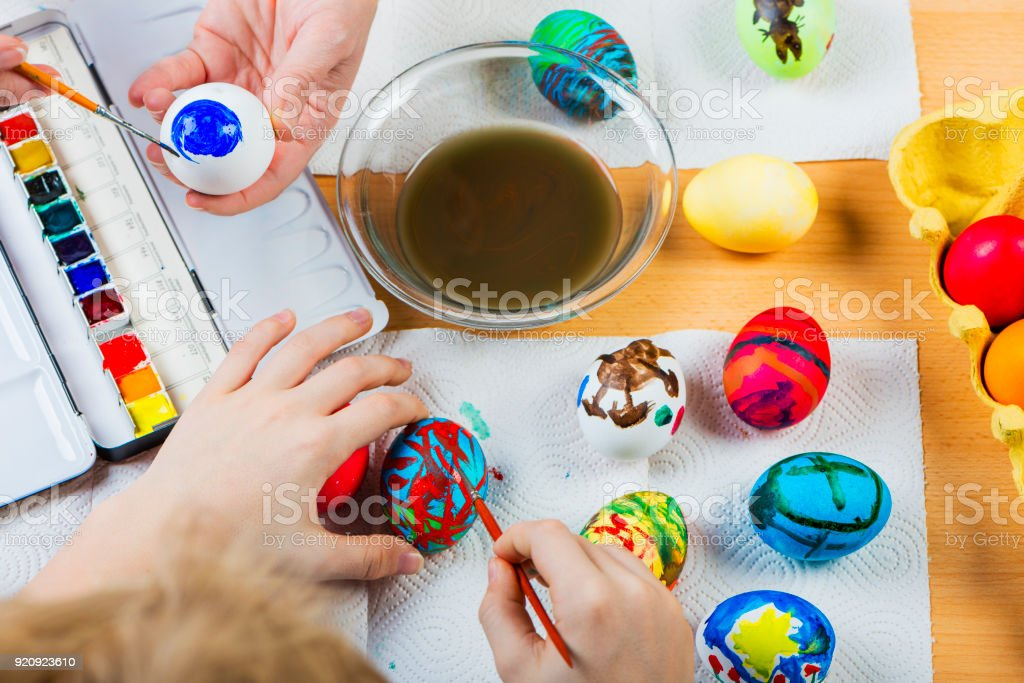 Mother And Child Coloring Easter Eggs Stock Photo & More ...