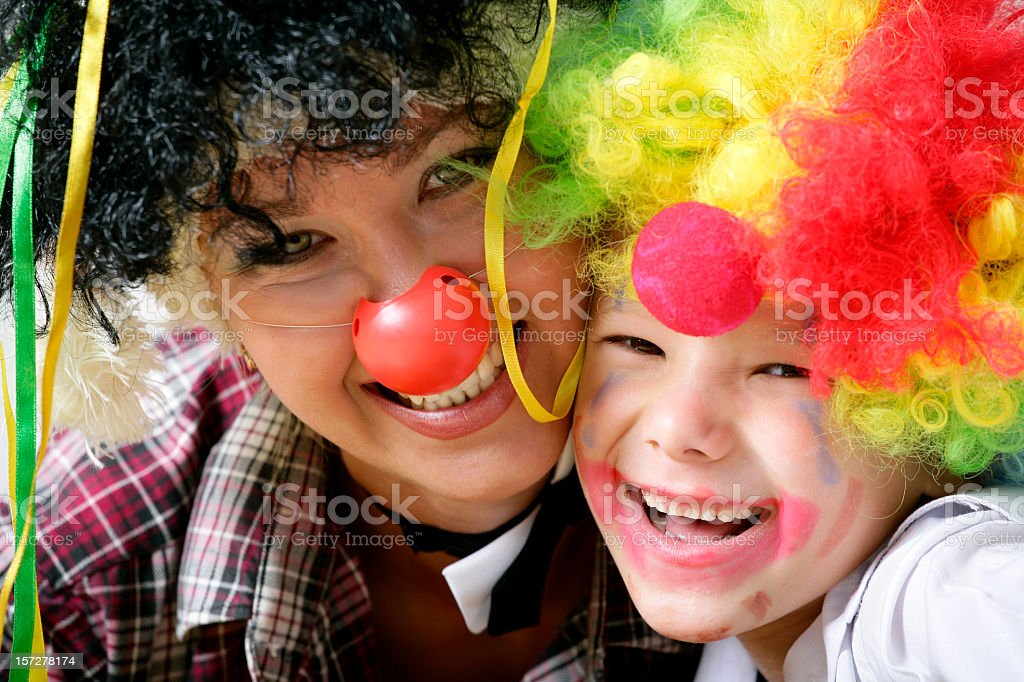 Mother and child dressed up as funny clowns royalty-free stock photo