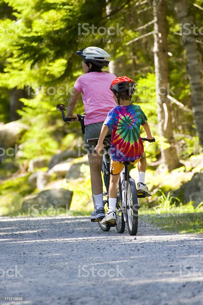 Mother and child enjoy tandem cycling stock photo