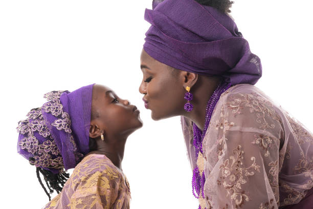 Mother and child girl kissing.African traditional clothing .Isolated stock photo