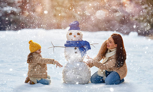 mother and child girl on a winter walk in nature Happy family! Mother and child girl on a winter walk in nature. christmas fun stock pictures, royalty-free photos & images