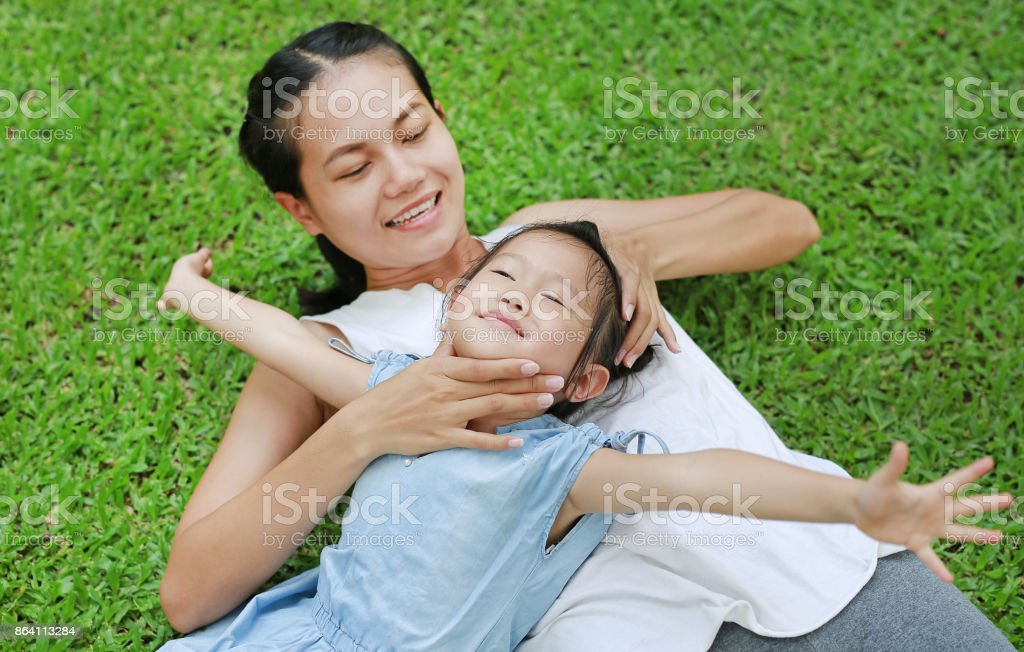 Mother and child girl playing in the garden. royalty-free stock photo