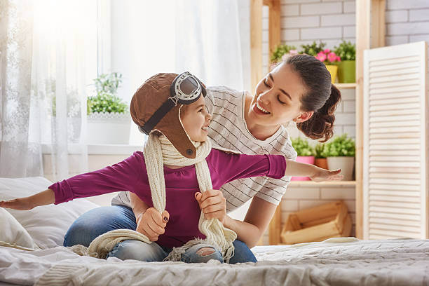 Mother and child girl playing stock photo