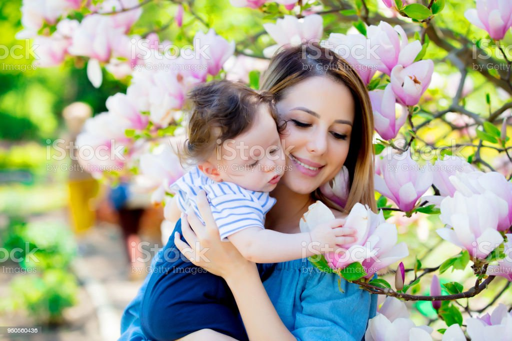 mother and child have a lasure in Magnolia garden stock photo