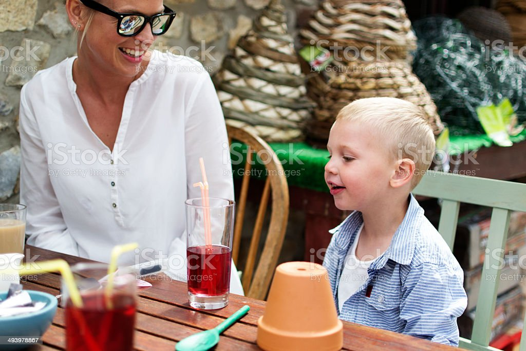 Mother and child in a café royalty-free stock photo