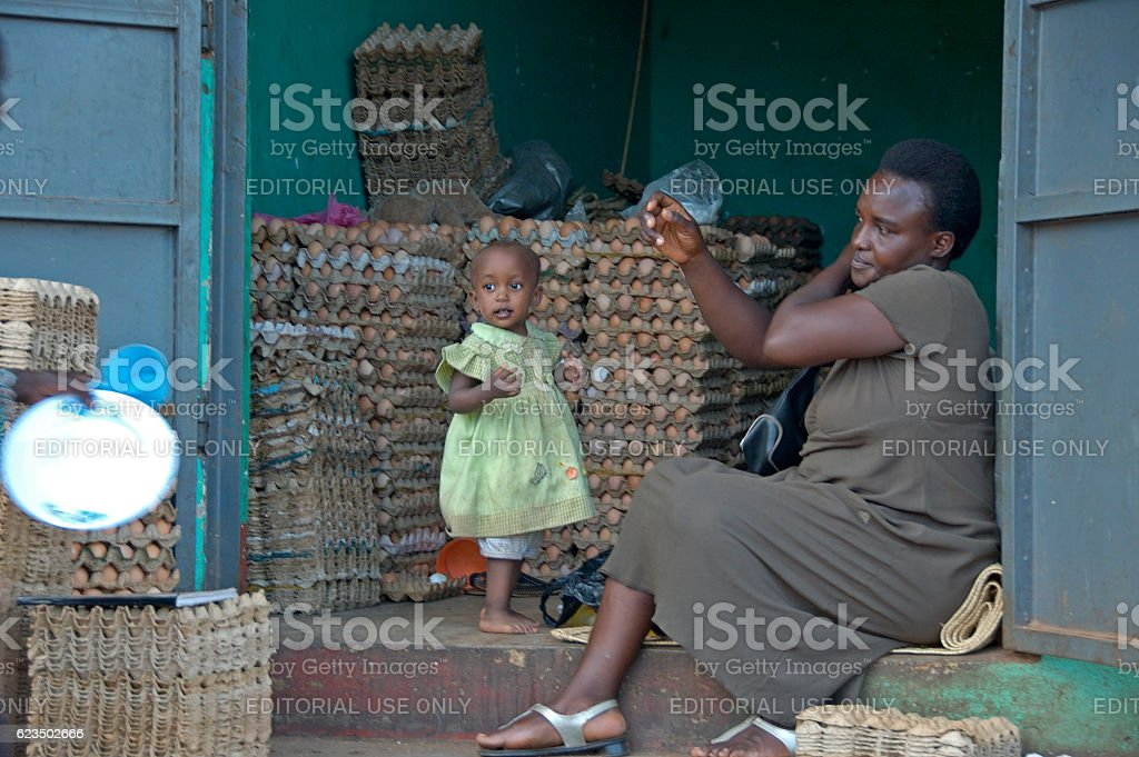 Mother and child in there shop selling eggs. stock photo
