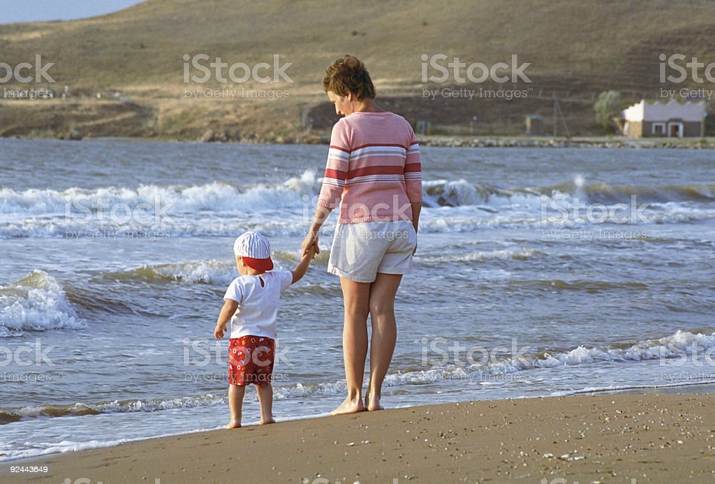Mother and child on a beach royalty-free stock photo