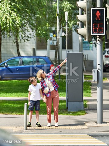 Mother and child stand at the crosswalk